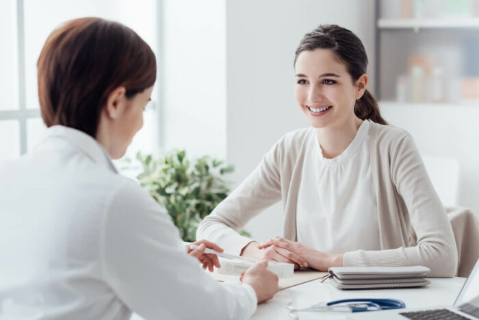 doctor talking with young woman