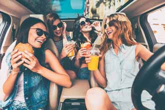 Group of women in a car laughing
