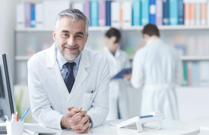Smiling doctor at desk